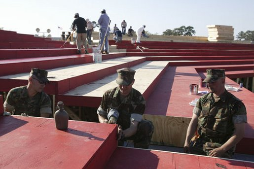 Navy Seabees construct the stage at the event site where President George W. Bush will address the troops Thursday at Camp Lejeune in Jacksonville, N.C., Wednesday, April 2, 2003. White House photo by Paul Morse