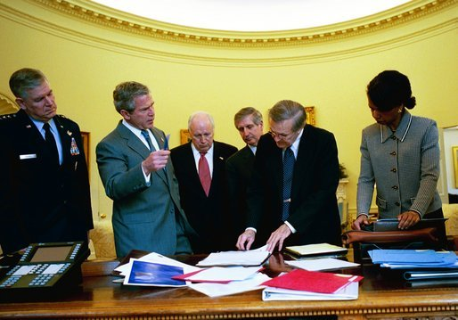 During his morning briefing, President George W. Bush reviews the progress of the war with members of the War Council Wednesday, April 2, 2003. Pictured with the President are, from left, Chairman of the Joint Chiefs of Staff Richard B. Myers, Vice President Dick Cheney, Chief of Staff Andy Card, Secretary of Defense Donald Rumsfeld and National Security Advisor Condoleezza Rice. White House photo by Eric Draper