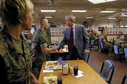 President George W. Bush greets Marines before sitting down with them for lunch at Camp Lejeune in Jacksonville, N.C., Thursday, April 3, 2003. White House photo by Paul Morse
