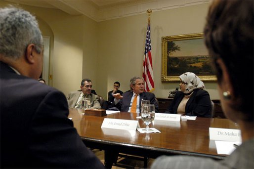 President George W. Bush talks with Zainab Al-Suwaij during a meeting with Iraqi-Americans and free Iraqis who are living in the United States in the Roosevelt Room Friday, April 4, 2003. President of the American Islamic Congress, Ms. Al-Suwaij was born in Southern Iraq and participated in the 1991 uprising against Saddam Hussein before escaping to America. White House photo by Eric Draper.