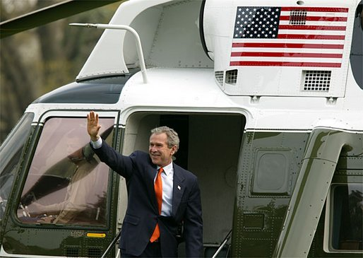 President George W. Bush waves as he departs for Camp David from the South Lawn Friday, April 4, 2003. White House photo by Paul Morse.