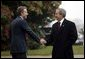 President George W. Bush is greeted by British Prime Minister Tony Blair at Hillsborough Castle near Belfast, Ireland, April 7, 2003. White House photo by Eric Draper.