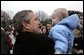 Welcomed by an enthusiastic crowd, President George W. Bush holds a child during an airport arrival greeting at RAF Aldergrove airport in Northern Ireland, Monday, April 7, 2003. White House photo by Eric Draper.