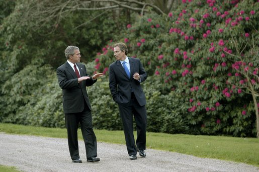 President George W. Bush and British Prime Minister Tony Blair walk through the grounds of Hillsborough Castle in Northern Ireland, Monday, April 7, 2003. White House photo by Eric Draper.