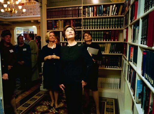 "Laura Bush tours the Dwight D. Eisenhower Executive Office Building Library after launching the Executive Office of the President Virtual Library Tuesday, April 8, 2003. ""This library is a valuable center of knowledge within the White House. Since it opened 125 years ago, the library has grown from a small reference collection to a modern research facility, with a strong concentration in American history and government,"" Mrs. Bush said. ""Launching the EOP Virtual Library today is a perfect start to National Library Week. This week is not only a celebration of our nation's libraries, but of the people who make them great."" White House photo by Susan Sterner"