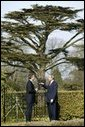 President George W. Bush and British Prime Minister Tony Blair talk alone in the gardens of Hillsborough Castle near Belfast, Northern Ireland, Tuesday, April 8, 2003. White House photo by Paul Morse