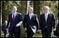President George W. Bush walks with British Prime Minister Tony Blair, center, and Irish Prime Minister Bertie Ahern at Hillsborough Castle as he prepares to depart Northern Ireland Tuesday, April 8, 2003.   White House photo by Paul Morse