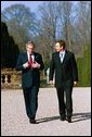 President Bush and Prime Minister Tony Blair of Great Britain walk on the grounds at Hillsborough Castle. Hillsborough, Northern Ireland, April 8, 2003. White House photo by Eric Draper.