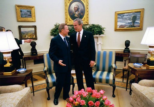 President George W. Bush talks with President Rudolf Schuster of the Slovak Republic in the Oval Office Wednesday, April 9, 2003. A member of the coalition bringing freedom to Iraq, Slovakia is contributing a nuclear/biological/chemical weapons team that is based in Kuwait. White House photo by Eric Draper.