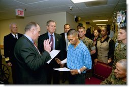 President George W. Bush attends the U.S. Citizenship Ceremony for Marine Corps Lance Cpl. O.J. Santamaria of Daly City, Calif., at the National Naval Medical Center in Bethesda, Md., Friday, April 11, 2003.  White House photo by Eric Draper