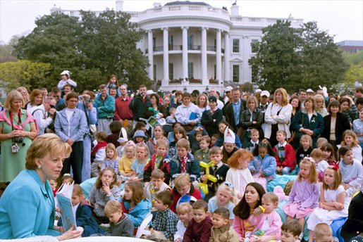 "Lynne Cheney reads from her book, ""America: A Patriotic Primer,"" at the White House Easter Egg Roll Monday, April 21, 2003. Accompanying Mrs. Cheney, several Cabinet members and authors also read to children during the day. White House photo by Susan Sterner"