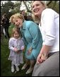 Visiting one-on-one with many families and children, Lynne Cheney poses for pictures on the South Lawn at the White House Easter Egg Roll Monday, April 21, 2003. White House photo by David Bohrer