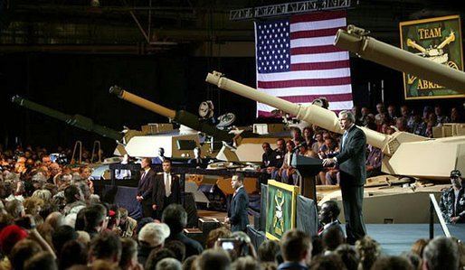 "President George W. Bush addresses employees of the Lima Army Tank Plant, where the Abrams M1A2 tank is built, in Lima, Ohio, April 24, 2003. ""I'm here to thank you all for your service to our country, and thank you for the vital contribution you have made to peace and freedom,"" said the President in his remarks. ""And each of you have had a part in this mission. Each of you are a part to making sure this country is strong enough to keep the peace."" White House photo by Paul Morse"