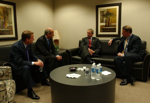 President George W. Bush meets with, from left, William Clay Ford Jr., Chairman & CEO of Ford Motor Company; Dieter Zetsche, President & CEO of Chrysler Group; and Richard Wagoner, President & CEO of General Motors Corp., at the Ford Community and Performing Arts Center in Dearborn, Mich., Monday, April 28, 2003. White House photo by Tina Hager