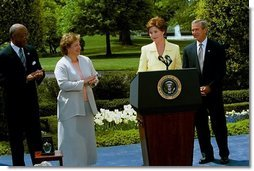 Laura Bush introduces the President George W. Bush during a ceremony honoring National Teacher of the Year Betsy Rogers, left, as Secretary of Education Rod Paige looks on at the White House April 30, 2003.  White House photo by Susan Sterner