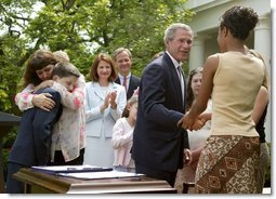 President George W. Bush greets Tamara Brooks after signing the S. 151, PROTECT Act of 2003, in the Rose Garden Wednesday, April 30, 2003. Brooks, 17, was rescued after an AMBER Alert was issued throughout Orange County, Calif., alerting the community of her abduction. Donna Norris, left, embraces her son Ricky after the bill signing. The AMBER Alert system is named in honor of her 9-year-old daughter, Amber Hagerman, who was abducted while playing near her Arlington, Texas, home and later found murdered.   White House photo by Paul Morse