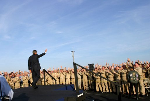 The President acknowledges sailors after addressing the nation from the flight deck of the USS Abraham Lincoln May 1, 2003. White House photo by Paul Morse