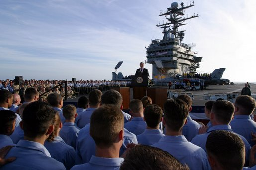 President George W. Bush addresses sailors and the nation from the flight deck of the USS Abraham Lincoln of the coast of San Diego, California May 1, 2003. White House photo by Paul Morse
