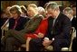 "President George W. Bush and Laura Bush bow their heads in prayer during a ceremony marking today as the National Day of Prayer in the East Room Thursday, May 1, 2003. ""Today we recognize the many ways our country has been blessed, and we acknowledge the source of those blessings. Millions of Americans seek guidance every day in prayer to the Almighty God. I am one of them,"" said the President in his remarks. White House photo by Tina Hager"