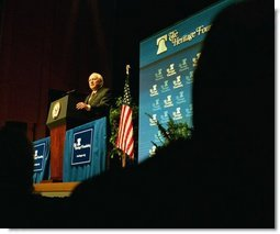 "Vice President Dick Cheney addresses the Heritage Foundation at the Ronald Reagan Building and International Trade Center in Washington, D.C., May 1, 2003. ""A vital element of our strategy against terror is to break the alliances between terrorist organizations and terrorist states,"" Vice President Cheney said. ""In the case of Iraq, President Bush made it absolutely clear that the United States would not tolerate a growing danger from this dictator and his brutal regime. Today, Saddam Hussein's regime is history.""  White House photo by David Bohrer"