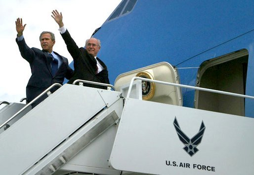 President George W. Bush and Prime Minister John Howard of Australia board Air Force One at Moffet Federal Airfield in Santa Clara, Calif., Friday, May 2, 2003. The Prime Minister is accompanying the President to his ranch in Crawford, Texas for the weekend. White House photo by Susan Sterner