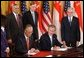 President George W. Bush and Singapore Prime Minister Chok Tong Goh sign a free trade agreement in the East Room Tuesday, May 6, 2003. White House photo by Tina Hager