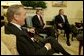 "During a meeting with Secretary of Defense Donald Rumsfeld, President George W. Bush announces L. Paul Bremer, center, as the presidential envoy to Iraq in the Oval Office Tuesday, May 6, 2003. ""He's a man of enormous experience; a person who knows how to get things done; he's a can-do type person,"" said the President of the former ambassador. White House photo by Paul Morse."