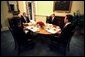 President George W. Bush has breakfast with Danish Prime Minister Anders Fogh Rasmussen, far right, National Security Advisor Condoleezza Rice, left, and Denmark's ambassador to the U.S. Ulrik Federspiel, in the private dining room of the White House Thursday, May 8, 2003. White House photo by Eric Draper