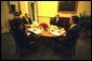President George W. Bush has breakfast with Danish Prime Minister Anders Fogh Rasmussen, at right, National Security Advisor Condoleezza Rice and Denmark's Ambassador to the U.S. Ulrik Federspiel, in the private dining room of the White House Thursday, May 8, 2003. White House photo by Eric Draper.