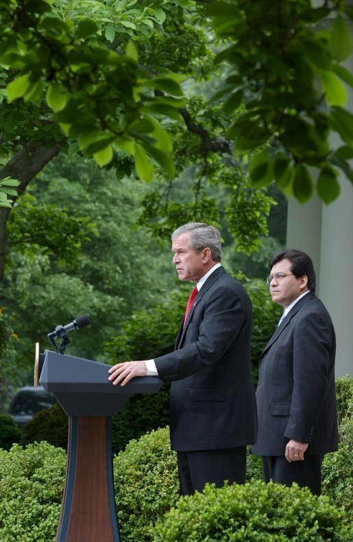 As Counsel Judge Alberto Gonzales stands by his side, President George W. Bush delivers remarks regarding his judicial nominations in the Rose Garden Friday, May 9, 2003. White House photo by Tina Hager.