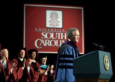 "President George W. Bush discusses peace in the Middle East during his Commencement Address at the University of South Carolina in Columbia, S.C., Friday, May 9, 2003. ""Across the globe, free markets and trade have helped defeat poverty, and taught men and women the habits of liberty,"" said the President. ""So I propose the establishment of a U.S.-Middle East free trade area within a decade, to bring the Middle East into an expanding circle of opportunity, to provide hope for the people who live in that region."" White House photo by Tina Hager. White House photo by Tina Hager"