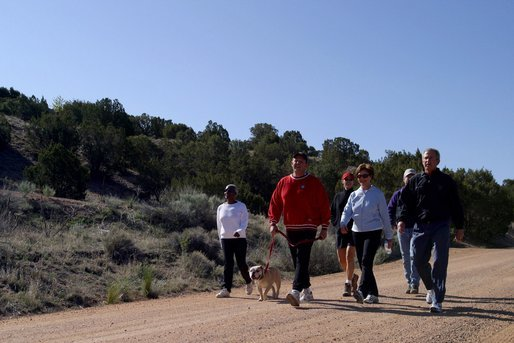 President George W. Bush and Laura Bush walk with Roland Betts, second left, and wife Lois Betts, and other guests Regan and Billy Gammon near the Bett's home outside Santa Fe, N.M., Saturday, May 10, 2003. White House photo by Susan Sterner