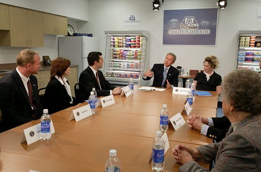 President George W. Bush discusses the tax cuts in his economic plan during a roundtable meeting with couples at Airlite Plastics in Omaha, Neb., Monday, May 12, 2003. White House photo by Susan Sterner