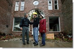 "President George W. Bush comforts Scott and Annette Rector in front of their destroyed business in Pierce City, Mo., Tuesday, May 13, 2003. ""You can't realize what it's like to see a tornado go right down the main street of a town and just wipe it out,"" said President Bush as he surveyed the damage from tornados that ripped through southwestern Missouri May 4. ""It's hard to envision. But a lot of people know you're suffering, and a lot of people are praying for you, and a lot of people care for you. And a lot of people wish you all the best.""  White House photo by Susan Sterner"