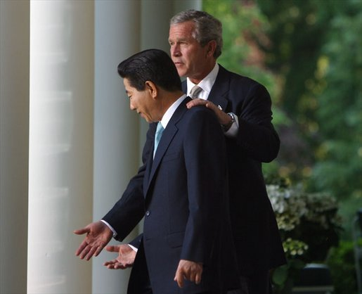 President George W. Bush and South Korean President Roh Moo-hyun in the Rose Garden on May 14, 2003. White House photo by Paul Morse.