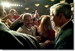 "President George W. Bush greets the gathered crowd after addressing the National Hispanic Prayer Breakfast in Washington, D.C., Thursday, May 15, 2003. ""It is appropriate that the group sponsoring this breakfast has the name Nueva Esperanza -- New Hope. Hope allows us to dream big, to pray bold, and to work hard for a better future. I want to thank you for your abiding hope, for your steadfast faith, and for your acts of love,"" said the President in his remarks.  White House photo by Eric Draper"