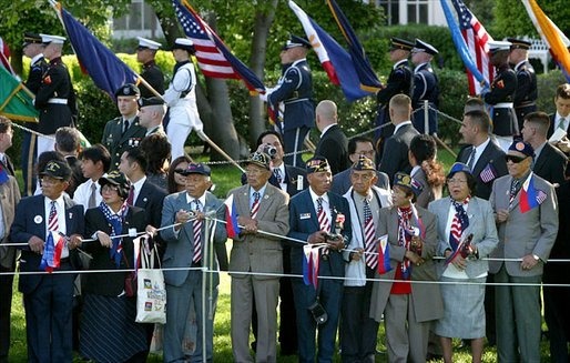 World War II Filipino-American veterans gather on the South Lawn to watch the State Arrival Ceremony for President Gloria Arroyo of the Philippines on the South Lawn Monday, May 19, 2003. White House photo by Lynden Steele.