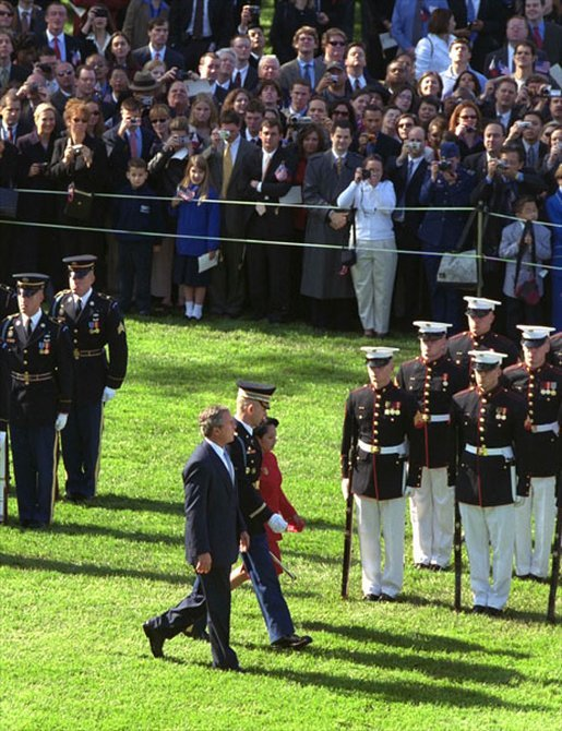 President George W. Bush and President Arroyo review the troops. White House photo by Paul Morse