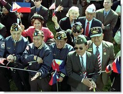 "World War II Filipino-American veterans cheer for Presidents Bush and Arroyo. ""I am proud of the contributions that Filipinos and Filipino Americans make to the American economy and society,"" said President Arroyo in her remarks. ""In a quiet, but equally substantive way, we can compare it to the contribution made by Philippine World War II veterans to the defense of our common freedom and security.""   White House photo by Tina Hager"