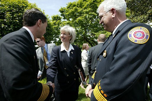 Interior Secretary Gale Norton greets firefighters after the President's remarks on his Healthy Forests Initiative in The East Garden Tuesday, May 20, 2003. White House photo by Susan Sterner.
