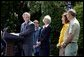President George W. Bush discusses his plan for wildfire prevention and forest stewardship, the Healthy Forests Initiative, in The East Garden Tuesday, May 20, 2003. Standing on stage with the President are, from left, Agriculture Secretary Veneman, Interior Secretary Gale Norton, Fire Management Officer Andrea Gilham and Wildlife and Fire Staff Officer Rex Mann. White House photo by Susan Sterner.