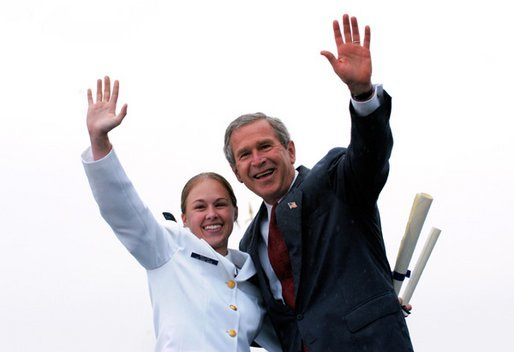 After receiving her degree from President George W. Bush, a cadet and the President wave to the gathered crowd during the United States Coast Guard Academy Commencement in New London, Conn., Wednesday, May 21, 2003. White House photo by Eric Draper.