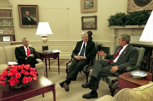 President George W. Bush meets with Senator John Danforth, the President's Special Envoy to the Sudan, center, and Secretary of State Colin Powell in the Oval Office Wednesday, May 21, 2003. White House photo by Susan Sterner.