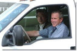 President George W. Bush and Japanese Prime Minister Junichiro Koizumi begin a tour of the President's ranch near Crawford, Texas, after the Prime Minister's arrival Thursday afternoon, May 22, 2003.  White House photo by Tina Hager