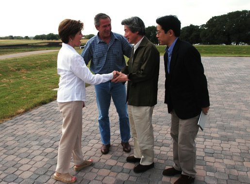 President George W. Bush and Laura Bush greet Japanese Prime Minister Junichiro Koizumi at their Texas ranch Thursday afternoon, May 22, 2003. White House photo by Eric Draper