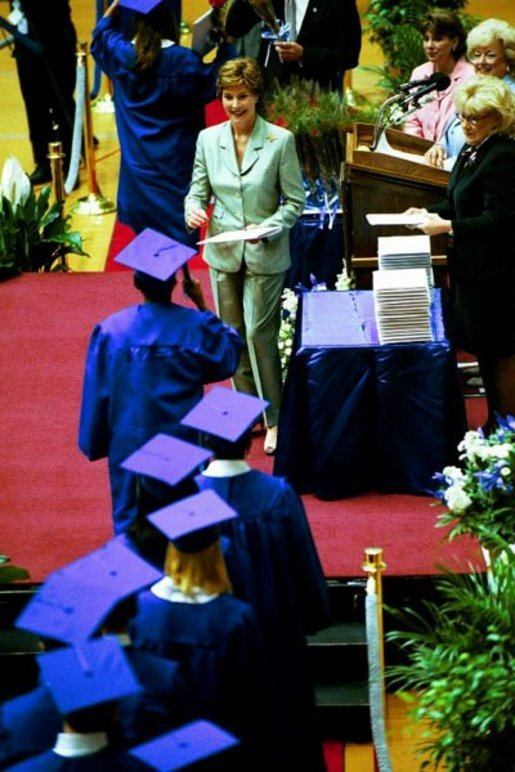 Mrs. Bush awards diplomas at the Fort Campbell High School Graduation at the Dunn Center at the Austin Peay State University in Fort Campbell, Ky., May 23, 2003. White House photo by Tina Hager