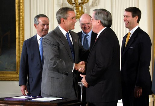 President George W. Bush shakes the hand of Congressman Bill Thomas, R-Calif., after signing the Jobs and Growth Tax Reconciliation Act of 2003 in the East Room Wednesday, May 28, 2003. Also pictured are, from left, Secretary of Commerce Donald Evans, Secretary of the Treasury John Snow and Senate Majority Leader Bill Frist, R-Tenn. White House photo by Eric Draper
