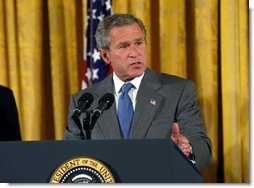 "President George W. Bush discusses the benefits of the Jobs and Growth Tax Reconciliation Act of 2003 in the East Room Wednesday, May 28, 2003. ""We are helping workers who need more take-home pay. We're helping seniors who rely on dividends. We're helping small business owners looking to grow and to create more new jobs. We're helping families with children who will receive immediate relief,"" said the President in his remarks.  White House photo by Eric Draper"