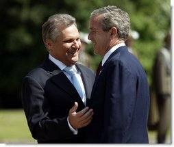 President George W. Bush and President of Poland Aleksander Kwasniewski talk during the President's trip to the Wawel Royal Palace in Krakow, Poland, Saturday, May 31, 2003.  White House photo by Paul Morse