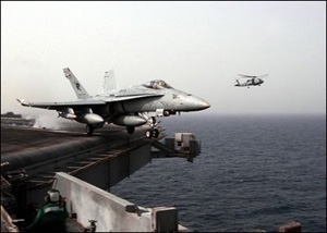 "The Arabian Gulf (Mar. 20, 2003) -- An F/A-18C Hornet assigned to the ""Stingers"" of Strike Fighter Squadron One One Three (VFA 113) launches from the flight deck aboard the aircraft carrier USS Abraham Lincoln (CVN 72).U.S. Navy photo by Photographer's Mate 3rd Class Philip A. McDaniel"